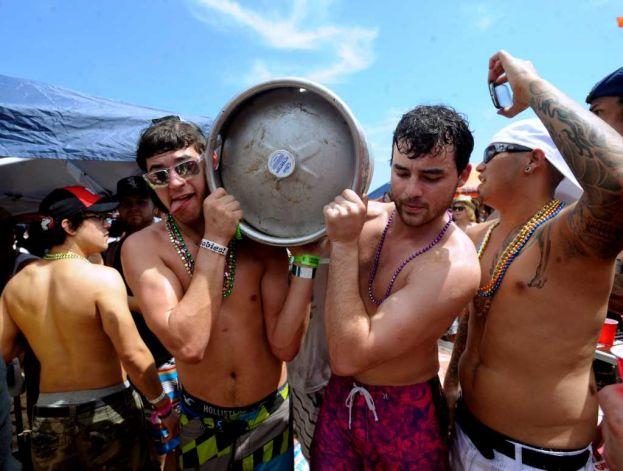 carrying beer keg at festival
